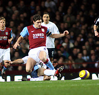 Photo: Mark Stephenson/Sportsbeat Images.<br /> Aston Villa v Tottenham Hotspur. The FA Barclays Premiership. 01/01/2008.Villa's Gareth Barry is challanged from behind