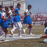 A Bengali girls group stick dances at a stadium in Dhaka, Bangladesh, celebrating thier recent independence from Pakistan. 1977 photo