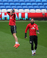 Gareth Bale of Wales (l) jokes with Joe Ledley of Wales ® as they have fun during Wales football team training at the Cardiff city Stadium in Cardiff , South Wales on Saturday 8th October 2016, the team are preparing for their FIFA World Cup qualifier home to Georgia tomorrow. pic by Andrew Orchard, Andrew Orchard sports photography