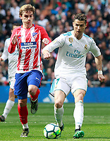Real Madrid's Cristiano Ronaldo (r) and Atletico de Madrid's Antoine Griezmann during La Liga match. April 8,2018. (ALTERPHOTOS/Acero)