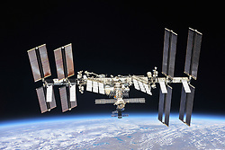 November 20, 2018 - Earth Atmosphere - The largest and most complex international construction project in space began on the steppes of Kazakhstan 20 years ago today. Atop its Proton rocket, on Nov. 20, 1998, the Zarya Functional Cargo Block thundered off its launch pad at the Baikonur Cosmodrome to serve as a temporary control module for the nascent International Space Station. In this image from October 2018, the fully completed station continues its mission to conduct microgravity research and experiments, ranging from human physiology to astronomy aboard humanity's only orbital laboratory. (Credit Image: © NASA/ZUMA Wire/ZUMAPRESS.com)
