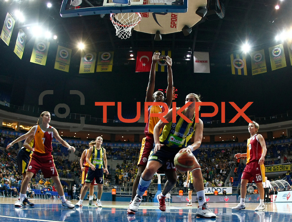 Fenerbahce's İvana Matovic (F) and Galatasaray's Sancho Lyttle (C) during their Turkish Basketball woman league derby match Fenerbahce between Galatasaray at Ulker Sports Arena in Istanbul, Turkey, wednesday, December 26, 2012. Photo by Aykut AKICI/TURKPIX