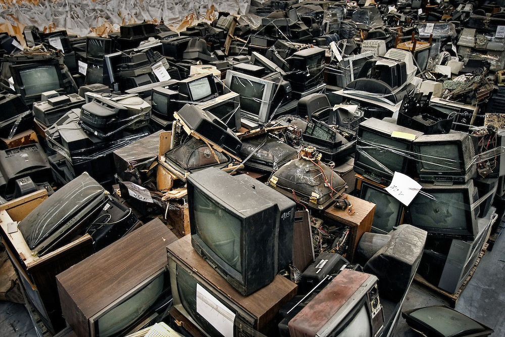 Analogue TVs await their fate in a recycling centre, thousands of the old tech TVs are discarded as Australia moves to digital television 14/05/2010 Pic By Craig Sillitoe SPECIAL 000 melbourne photographers, commercial photographers, industrial photographers, corporate photographer, architectural photographers, This photograph can be used for non commercial uses with attribution. Credit: Craig Sillitoe Photography / http://www.csillitoe.com<br /> <br /> It is protected under the Creative Commons Attribution-NonCommercial-ShareAlike 4.0 International License. To view a copy of this license, visit http://creativecommons.org/licenses/by-nc-sa/4.0/.