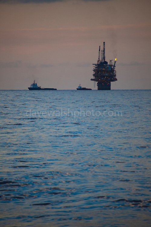 """Oil platform, in the Gulf of Mexico. There are nearly 5,000 functioning oil platforms in the Gulf of Mexico, and 27,000 abandoned wells. This mage can be licensed via Millennium Images. Contact me for more details, or email mail@milim.com For prints, contact me, or click """"add to cart"""" to some standard print options."""