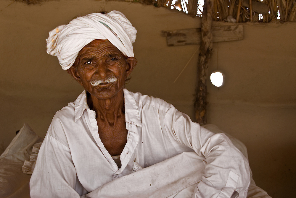 Ungaram, a village elder and a Pakistani earthquake refugee, in a camp tent.