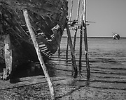 Dhow'n and out in Vilankulos (apologies for the aweful pun) This old dhow fishing boat aground in Vilanculos harbour, Mozambique seems to have been there for many years in a permanent state of (dis)repair