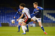 Davis Keillor-Dunn (10) of Oldham Althletic Alex Gilliead (8) of Scunthorpe United  battles for possession during the EFL Sky Bet League 2 match between Oldham Athletic and Scunthorpe United at Boundary Park, Oldham, England on 14 November 2020.