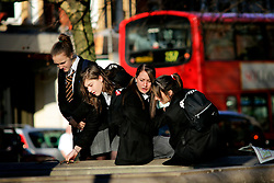 UK ENGLAND LONDON 13MAR07 - Schoolgirls wearing uniform play at a fountain in Sloane Square, a wealthy part of west London.. . jre/Photo by Jiri Rezac. . © Jiri Rezac 2007. . Contact: +44 (0) 7050 110 417. Mobile:  +44 (0) 7801 337 683. Office:  +44 (0) 20 8968 9635. . Email:   jiri@jirirezac.com. Web:    www.jirirezac.com. . © All images Jiri Rezac 2007 - All rights reserved.