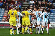 Huddersfield players confront the referee as they thought Scott Wootton of Leeds United should have received a 2nd yellow card. Skybet football league Championship match, Huddersfield Town v Leeds United at the John Smith's Stadium in Huddersfield, Yorks on Saturday 7th November 2015.<br /> pic by Chris Stading, Andrew Orchard sports photography.