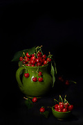Ceramic pitcher with ripe cherries on black background.<br /> This picture is registered as nft on blockchain and is available in a limited edition of 10 pieces. Actually you can purchase the #1 of 10 here: https://wax.atomichub.io/explorer/asset/1099538062105
