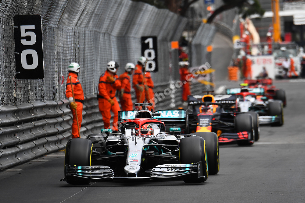 Lewis Hamilton (Mercedes), Max Verstappen (Red Bull-Renault) and the rest of the field pass marshals on the track during the 2019 Monaco Grand Prix. Photo: Grand Prix Photo