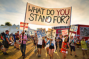 Shangri La is a festival of contemporary performing arts held each year within Glastonbury Festival. The theme for the 2015 Shangri La was Protest. Shangri La. Political protesters demonstratr against apathy in the young