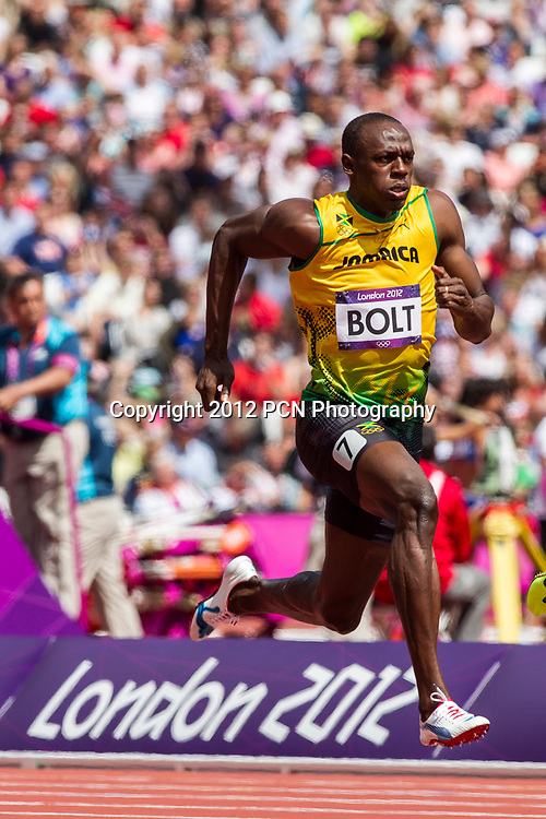 Usain Bolt (JAM) competing in the Men's 100m Round 1 at the Olympic Summer Games, London 2012