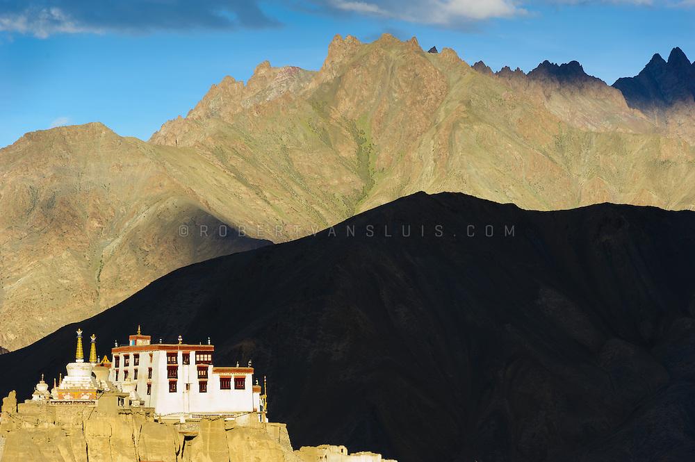 Last rays of sunlight illuminate Lamayuru Monastery, Lamayuru, Ladakh, India