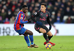 Arsenal's Alexis Sanchez (right) and Crystal Palace's Jeffrey Schlupp in action during the Premier League match at Selhurst Park, London, Thursday 28th December 2017