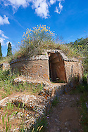 Etruscan circular Tumulus Tomb in one of the streets of the Necropoli della Banditaccia, Cerveteri, 6th century BC,  Italy. A UNESCO World Heritage Site .<br /> <br /> Visit our ETRUSCAN PHOTO COLLECTIONS for more photos to buy as buy as wall art prints https://funkystock.photoshelter.com/gallery-collection/Pictures-Images-of-Etruscan-Historic-Sites-Art-Artefacts-Antiquities/C0000GgxRXWVMLyc