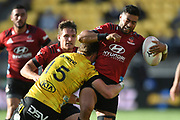 Crusaders Richie Mo'unga is tackled by Hurricanes Jordie Barrett in the Super Rugby match, Hurricanes v Crusaders, Sky Stadium, Wellington, Sunday, April 11, 2021. Copyright photo: Kerry Marshall / www.photosport.nz