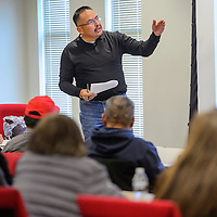 Anthony Spencer with the Department of Navajo Veterans' Affairs talks to a group of veterans during a meeting at the Navajo Nation Department of Transportation in Tse Bonito Thursday.