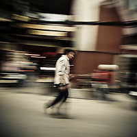 Man walking through French Quarter, Hanoi, Vietnam