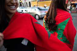 © Licensed to London News Pictures. 15/06/2018. Manchester, UK. Women wearing Moroccan flags . People celebrate Eid-ul-Fitr , the end of a month of fasting during Ramadan , in Rusholme in Manchester . Photo credit: Joel Goodman/LNP