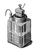 Wet Battery: Leclance cell, invented c1866. Glass vessel containing zinc rod, solution of chloride of ammonia, and porous block of carbon surrounded by pieces of carbon manganese dioxide and sealed with pitch.