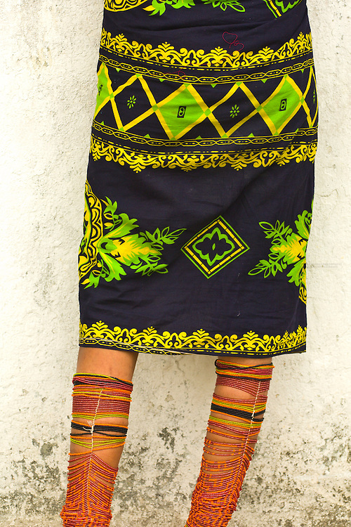 Kuna Indian woman selling in native costume with beaded leggings, Paseo de Las Bovedas, Casco Viejo (the Old City), San Felipe, Panama City, Panama