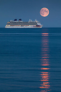 The Harvest Moon rises above P&O Cruises' largest ship, Britannia as she sits at anchor in Weymouth Bay. The cruise industry has suffered a complete shutdown during the covid-19 pandemic and many vessels are currently waiting at various anchorages around the coast of Great Britain and the world.<br /> Picture date Tuesday 1st September, 2020.<br /> Picture by Christopher Ison. Contact +447544 044177 chris@christopherison.com