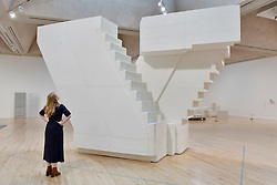 """© Licensed to London News Pictures. 11/09/2017. London, UK. A staff member views """"Untitled (Stairs)"""", 2001, at the preview of an exhibition featuring works by artist Rachel Whiteread at Tate Britain.  The exhibition spans her career over three decades and runs 12 September to 21 January 2018.   Photo credit : Stephen Chung/LNP"""