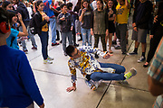 Sophomore Phillip Nguyen breakdances during the Best Buddies Special Education Dance at Milpitas High School in Milpitas, California, on April 21, 2017. (Stan Olszewski/SOSKIphoto)