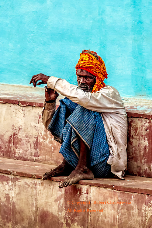 Warily Watching:  A solitary man watches the scenes of the street with a wariness born of daily experience, Assi Ghat, Varanasi India.