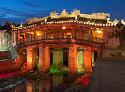 Illuminated night view of historic Japanese covered bridge in UNESCO heritage town of Hoian in Vietnam