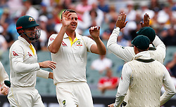 Australia's Josh Hazelwood celebrates the wicket of James Vince during day three of the Ashes Test match at the Adelaide Oval, Adelaide.