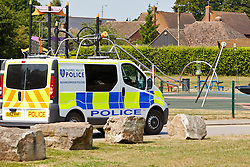 "© Licensed to London News Pictures.  18/07/2013. THAME, UK. A police van drives past a playground in Southern Road recreation ground in Thame, Oxfordshire where yesterday afternoon (Wed 17th) a 14-month old boy was hospitalised after picking up a discarded drugs wrap and chewing it. His condition is not thought to be serious but he was kept in overnight for observation.<br /> <br /> Police officers searched the scene for further paraphernalia and engaged with the council who will carry out additional cleaning at the recreation ground.<br /> <br /> Det Sgt Darren Cartwright of Thames Valley Police said: ""This was obviously a frightening experience for the boy's parents, but fortunately he doesn't seem to have been seriously harmed. It seems he had picked up a discarded paper wrap believed to have contained an illegal drug."" <br /> <br /> Photo credit: Cliff Hide/LNP"