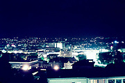 Night view of city centre of Stuttgart, Germany, early 1960s illuminated by electric neon lights