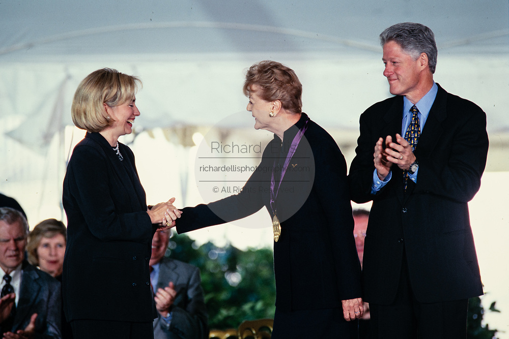 Actress Angela Lansbury is presented the National Medal of the Arts by President Bill Clinton and First Lady Hillary Clinton during a ceremony on the South Lawn of the White House September 29, 1997 in Washington, DC.
