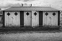 The symmetry of the diamond shaped windows caught my eye, along with the contrasting tones and the way in which the ridges on the metal roof seem to align with the vertical lines on the doors. As with virtually all of my pictures, this was captured in color, post processed using Silver Efx Pro 2to make it a far more interesting visual.