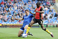 Cardiff City's Ben Turner (l) tackles Birmingham's Clayton Donaldson. Skybet football league championship match, Cardiff city v Birmingham city at the Cardiff city stadium in Cardiff, South Wales on Saturday 7th May 2016.<br /> pic by Carl Robertson, Andrew Orchard sports photography.