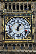 Workmen abseil down The Clock Tower of Parliament which houses Big Ben, to inspect the clock face for damage, London. The Clock Tower stands at over 96 metres high, the 7 metre wide clock faces have cast iron frames and house 312 pieces of pot opal glass.