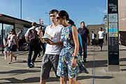 Visitors to London and commuters walk southwards over London Bridge, from the City of London - the capital's financial district founded by the Romans in the 1st century - to Southwark on the south bank, on 2nd August 2018, in London, England.