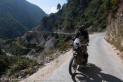 Trip co-leader Buddhi Singh riding a Royal Enfield Himalayan on Motorcycle Sherpa's Ride to the Heavens motorcycle adventure in the Himalayas of Nepal. Riding from Daman back to Kathmandu. Wednesday, November 13, 2019. Photography ©2019 Michael Lichter.