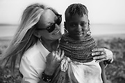 A  portrait in black and white of aTurkana girl wearing traditional stacked beaded necklaces, Lake Turkana, Loiyangalani,Kenya, Africa