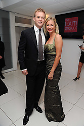 HOLLY BRANSON and FRED ANDREWS at The Reuben Foundation and Virgin Unite Haiti Fundraising dinner held at Altitude 360 in Millbank Tower, London on 26th May 2010.