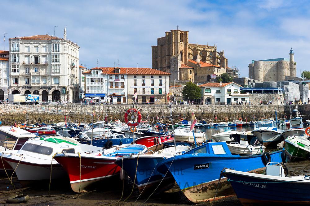 Seaside resort of Castro Urdiales in Northern Spain with 13th Century Iglesia de Santa Maria and El Faro de Castro lighthouse