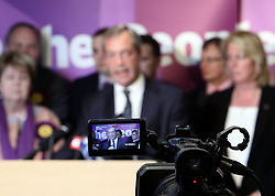 """© Licenced to London News Pictures. 26/05/2014. London. UK.  <br /> Nigel Farage, leader of the UK Independence Party (UKIP), is pictured in a television camera celebrating his European Parliamentary success in a press conference in London, May 26th 2014. The UKIP leader said his """"dream has become a reality"""" and UKIP is now the """"third force"""" in British politics after it topped the European polls.<br /> Photo Credit: Susannah Ireland"""