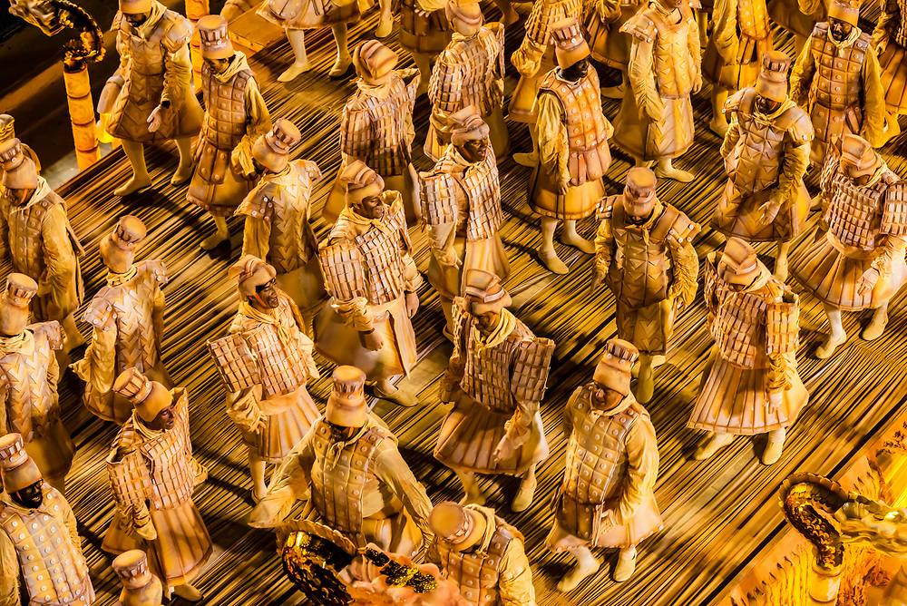 """One of the floats in the Carnaval parade of Unidos da Tijuca samba school contains men dressed as the Chinese Terracotta Warriors.            The theme of the parade is """"Where Dreams Live"""" and tells the history of architecture and urbanism. Sambadrome, Rio de Janeiro, Brazil."""