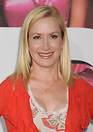 """WESTWOOD, CA - APRIL 28: Angela Kinsey arrives at the premiere of Universal Pictures' """"Bridesmaids"""" held at Mann Village Theatre on April 28, 2011 in Los Angeles, California."""