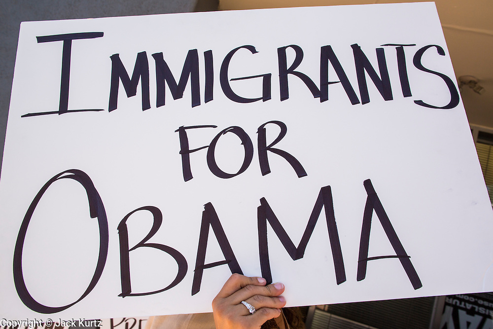 15 JUNE 2012 - PHOENIX, AZ:   A person in Phoenix carries sign supporting President Obama Friday. President Barrack Obama announced Friday that fffective immediately, young people who were brought to the US through no fault of their own as children and who meet certain criteria will be eligible to receive deferred action for a period of 2 years and that period will be subject to renewal. The announcement of the new executive order means that up to 800,00 young undocumented immigrants will not be deported and can continue their education in the US. The move was seen by many in the immigrant community as the closest thing they would get to seeing the DREAM Act passed in the near future.     PHOTO BY JACK KURTZ