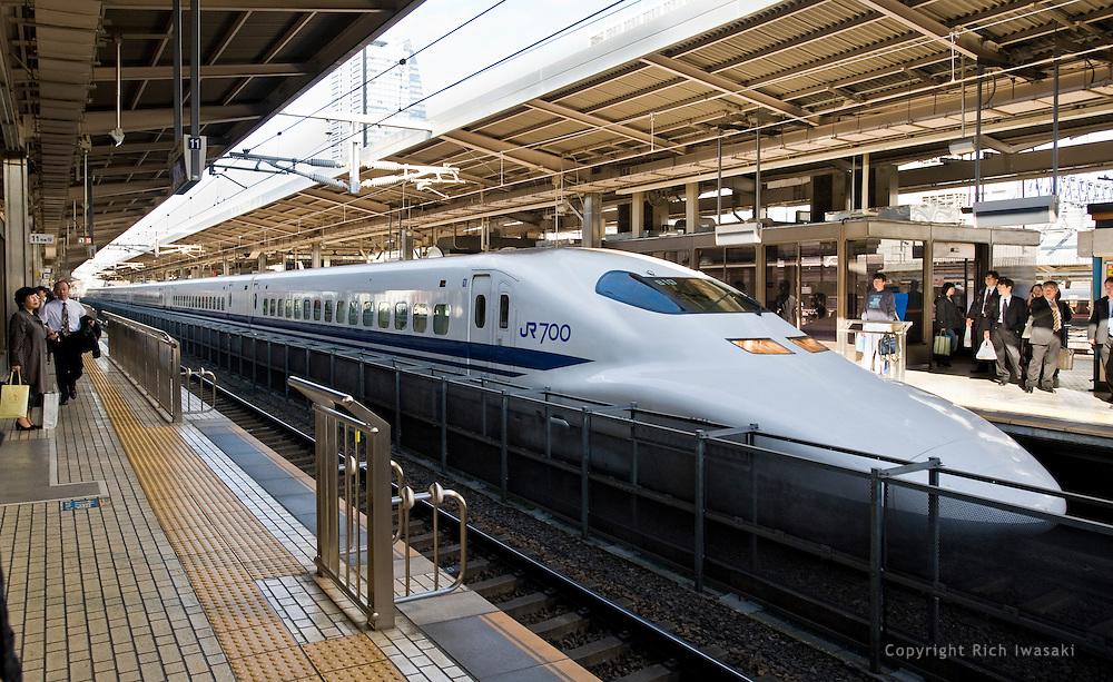 A Nozomi shinkansen train arrives at Nagoya Station, Aichi Prefecture, Japan..The Nozomi train is the fastest grade of shinkansen trains in Japan.