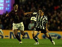 Photo: Chris Ratcliffe.<br /> Arsenal v Juventus. UEFA Champions League. Quarter-Finals. 28/03/2006.<br /> Jose Antonio Reyes of Arsenal clashes with Mauro Camoranesi of Juventus
