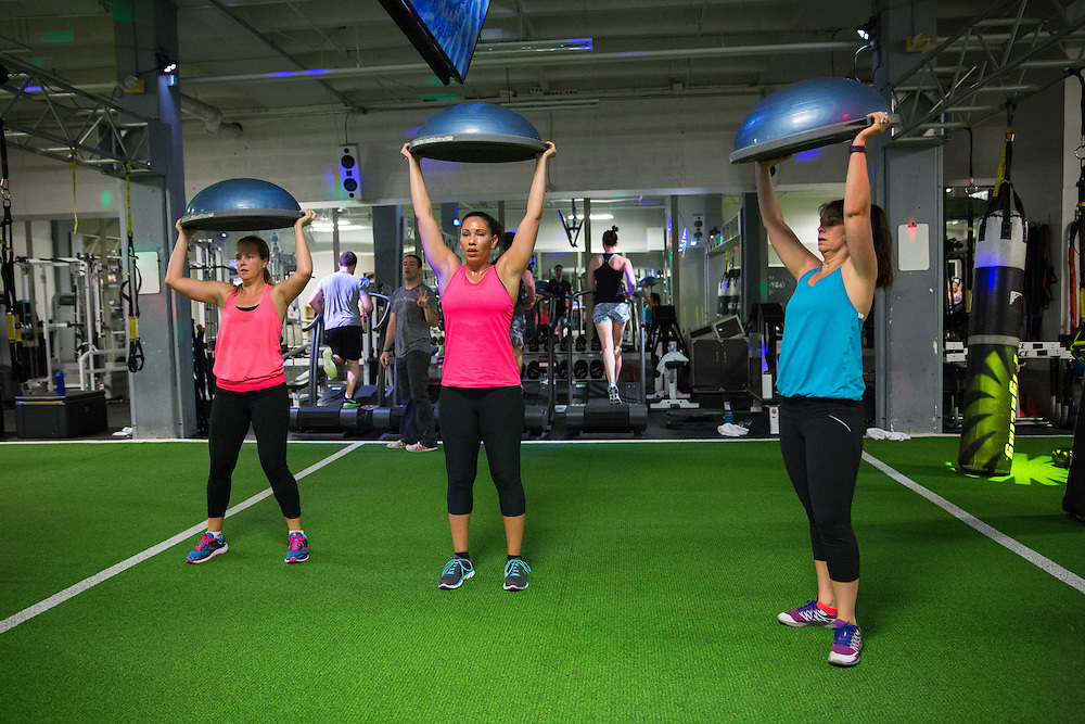 Reanna Ursin (center) works outs during a Chaos Conditioning class at The Forum Athletic Club at Lenox Mall in Atlanta on Sunday, April 24, 2016. Jeff Baird, owner and instructor for Chaos, pays the gym to hold his classes there several days a week. Photo by Kevin D. Liles for The Wall Street Journal<br /> <br /> GYMINGYM